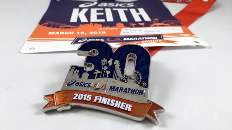 asics la marathon 2015 brand, medal, and race designs
